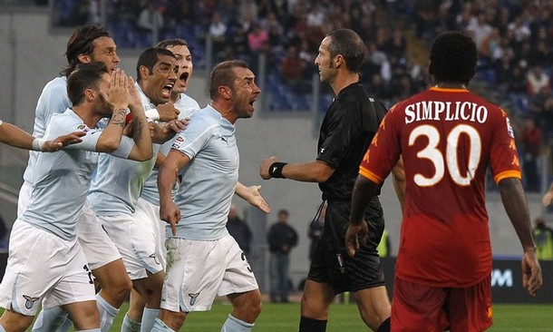 Lazio's players react against referee Emidio Morganti during the Italian Serie A soccer match against AS Roma in Rome